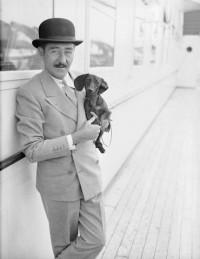 Adolphe Menjou Holding Daschund Aboard Ship