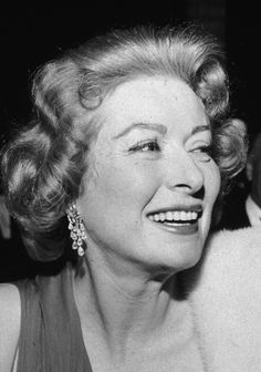 circa 1955: EXCLUSIVE British actress Greer Garson (1904 - 1996) smiling in an evening gown and a fur stole at an event in Hollywood, California. (Photo by Murray Garrett/Getty Images)