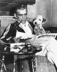 1930's publicity photo Boris Karloff reading with a friend