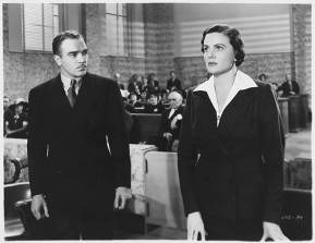 Walter Abel watches Frieda Inescort while they stand before the judge in the 1937 film Portia on Trial. (Photo by  John Springer Collection/CORBIS/Corbis via Getty Images)